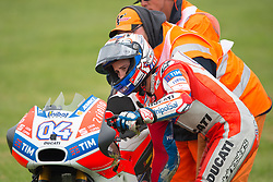 October 21, 2017 - Melbourne, Victoria, Australia - Italian rider Andrea Dovizioso (#4) of Ducati Team is helped by the marshals after coming off his bike at turn nine during the fourth free practice session at the 2017 Australian MotoGP at Phillip Island, Australia. (Credit Image: © Theo Karanikos via ZUMA Wire)