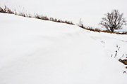 Snow gathered in the ditch by a rising field near Hillsboro, Kansas, in January 2010