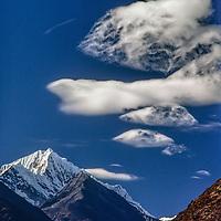 Lenticular clouds soar over Thamserku Peak in the Khumbu region of Nepal's Himalaya.