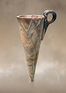 Minoan marble conical rhython, Zakros 1500-1400 BC; Heraklion Archaeological  Museum. .<br /> <br /> If you prefer to buy from our ALAMY PHOTO LIBRARY  Collection visit : https://www.alamy.com/portfolio/paul-williams-funkystock/minoan-art-artefacts.html . Type -   Heraklion   - into the LOWER SEARCH WITHIN GALLERY box. Refine search by adding background colour, place, museum etc<br /> <br /> Visit our MINOAN ART PHOTO COLLECTIONS for more photos to download  as wall art prints https://funkystock.photoshelter.com/gallery-collection/Ancient-Minoans-Art-Artefacts-Antiquities-Historic-Places-Pictures-Images-of/C0000ricT2SU_M9w