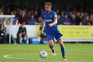 AFC Wimbledon defender Ben Purrington (3) dribbling during the EFL Sky Bet League 1 match between AFC Wimbledon and Portsmouth at the Cherry Red Records Stadium, Kingston, England on 13 October 2018.