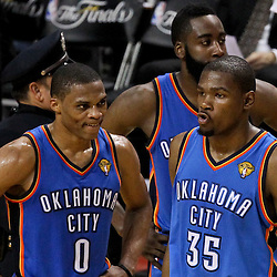 Jun 21, 2012; Miami, FL, USA; Oklahoma City Thunder small forward Kevin Durant (35), point guard Russell Westbrook (0) and guard James Harden (13) react during the fourth quarter in game five in the 2012 NBA Finals against the Miami Heat at the American Airlines Arena. Mandatory Credit: Derick E. Hingle-US PRESSWIRE