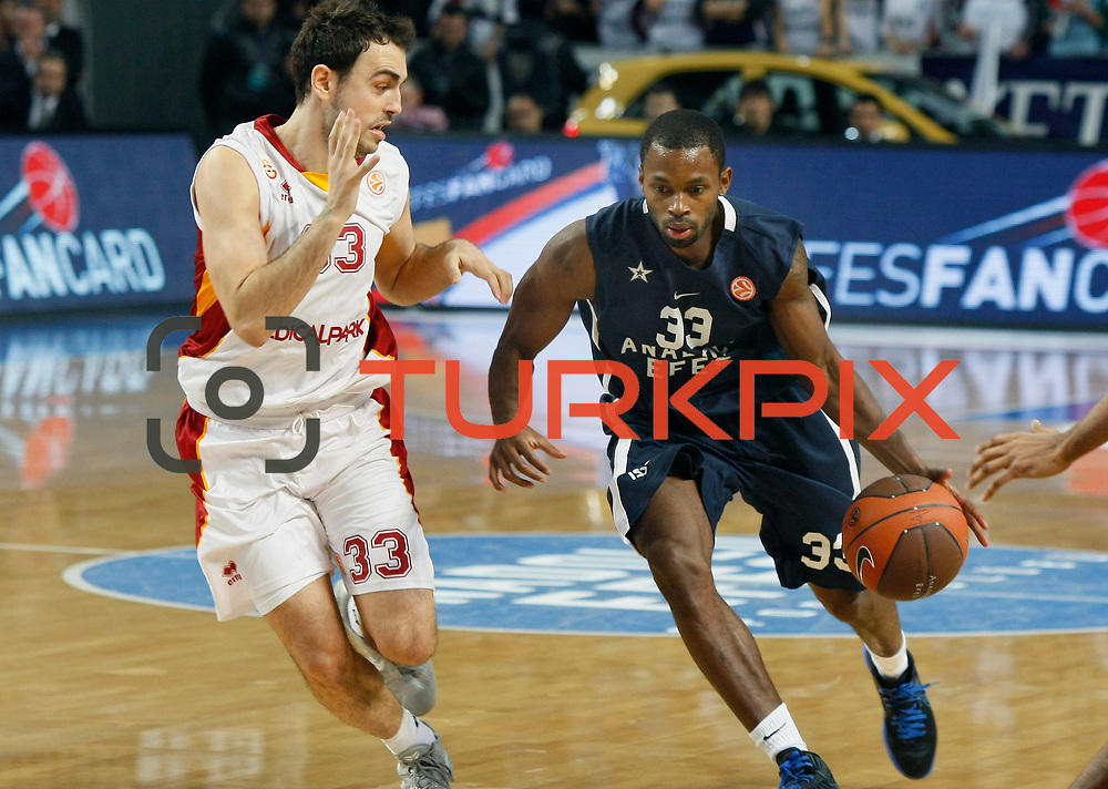 Anadolu Efes's Oliver Lafayette (R) and Galatasaray's Ender Arslan (L) during their Turkish Airlines Euroleague Basketball Top 16 Game 1 match Anadolu Efes between Galatasaray at Sinan Erdem Arena in Istanbul, Turkey, Thursday, January 19, 2012. Photo by TURKPIX