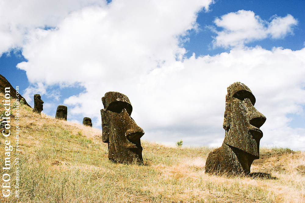 """Shot of several """"moai"""" on a hill inside the crater.  For more information on """"m oai,"""" see #17."""