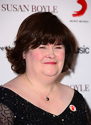 Susan Boyle press conference. <br /> Scottish singer Boyle, who found fame after appearing on Britain's Got Talent, attends press conference where she announces new single O Come, All Ye Faithful, a duet with Elvis Presley. Paul O'Grady hosts, at Sony Music Entertainment, London, United Kingdom. Monday, 28th October 2013. Picture by Nils Jorgensen / i-Images