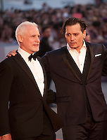 Producer Patrick McCormick and actor Johnny Depp at the gala screening for the film Black Mass at the 72nd Venice Film Festival, Friday September 4th 2015, Venice Lido, Italy.