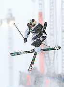 SHOT 12/18/10 10:44:54 AM - Simon Dumont of Bethel, Maine twists and spins while airborne high above the superpipe during the Supeprpipe Finals at the Nike 6.0 Open stop of the Winter Dew Tour at Breckenridge Ski Resort in Breckenridge, Co. Dumont would go on to win the event with a score of 94.50 on a stellar second run. The event features ski and snowboard slopestyle and superpipe. (Photo by Marc Piscotty / © 2010)