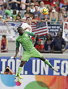 JACKSONVILLE, FL - JUNE 07:  Defender Geoff Cameron #20 of the United States goes up for a headball against forward Victor Moses #11 of Nigeria during the international friendly match at EverBank Field on June 7, 2014 in Jacksonville, Florida.  (Photo by Mike Zarrilli/Getty Images)