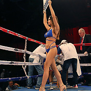 A ring card girl is seen between rounds during the Jonathan Gonzalez fight against Richard Rodriguez during a Telemundo boxing match between at Osceola Heritage Park on Friday, February 23, 2018 in Kissimmee, Florida.  (Alex Menendez via AP)