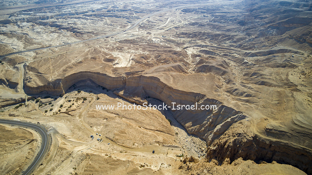 Aerial Photography with a drone. Route 90 that runs along the Dead Sea, Israel. Route 90 is the longest Israeli road, at about 480 kilometres (300 mi), and stretches from Metula and the northern border with Lebanon, along the western side of the Sea of Galilee, through the Jordan River Valley, along the western bank of the Dead Sea (making it the world's lowest road), through the Arabah valley, and until Eilat and the southern border with Egypt on the Red Sea. The central section of the road traverses the West Bank; while it passes near the city of Jericho, it runs through Area C and does not enter areas controlled by the Palestinian Authority.
