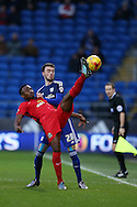 Foda Koita of Blackburn Rovers stretches to get to the ball ahead of Scott Malone of Cardiff city. Skybet football league championship match, Cardiff city v Blackburn Rovers at the Cardiff city stadium in Cardiff, South Wales on Saturday 2nd Jan 2016.<br /> pic by Andrew Orchard, Andrew Orchard sports photography.