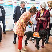 NLD/Doorn/20190322  - Prinses Margriet aanwezig bij congres Let's Connect, Prinses Margriet in gesprek met de eigenaar van een hulphond