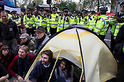 Police gather to begin talking to and trying to clear climate change activists from the Extinction Rebellion group as they vote on whether to leave peacefully or not at Oxford Street near to the Marble Arch camp in protest that the government is not doing enough to avoid catastrophic climate change and to demand the government take radical action to save the planet, on 24th April 2019 in London, England, United Kingdom. Extinction Rebellion is a climate change group started in 2018 and has gained a huge following of people committed to peaceful protests.