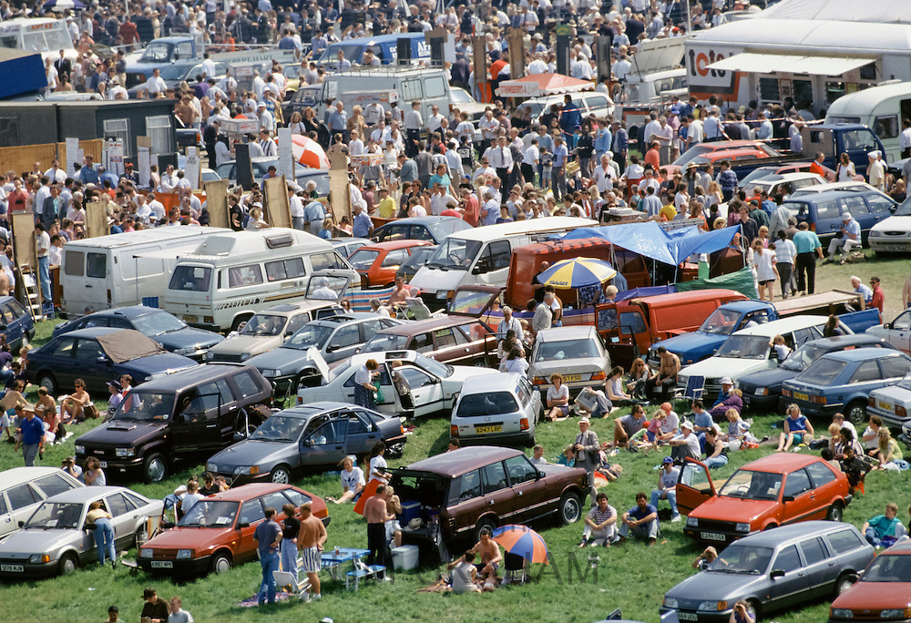 Crowds of spectactors in The Hill public area at Epsom Racecourse for Derby Day, UK
