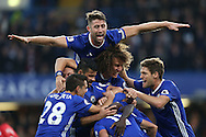 GOAL/CELE  :  Ngolo Kante of Chelsea celebrates after scoring his sides 4th goal with his team mates including Gary Cahill of Chelsea who jumps on top. Premier league match, Chelsea v Manchester Utd at Stamford Bridge in London on Sunday 23rd October 2016.<br /> pic by John Patrick Fletcher, Andrew Orchard sports photography.
