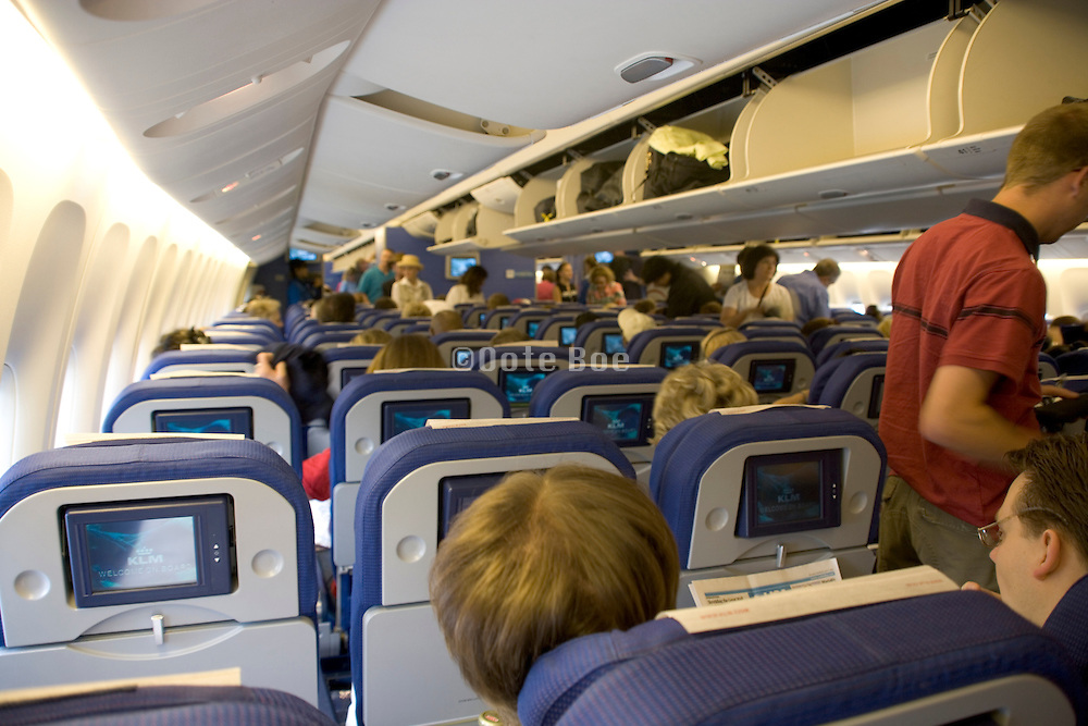 boarding passengers taking there seat before airplane is going to take off