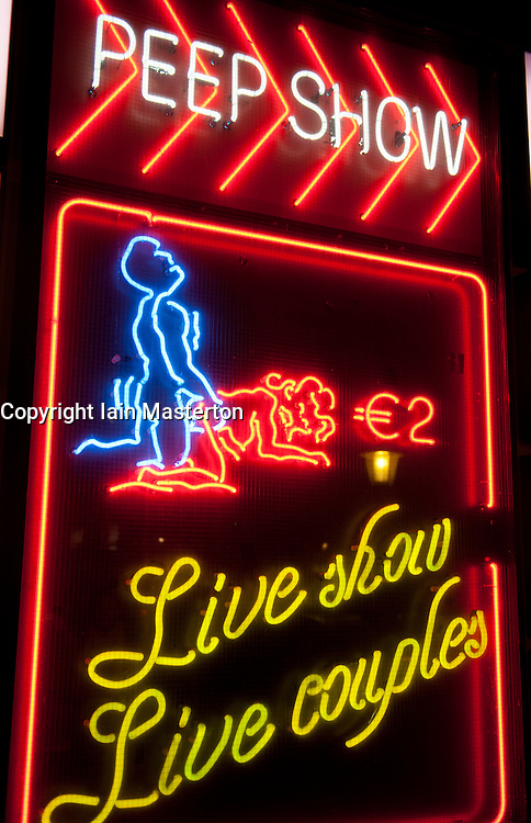 Neon signs outside sex club in Red light district of Amsterdam In The Netherlands