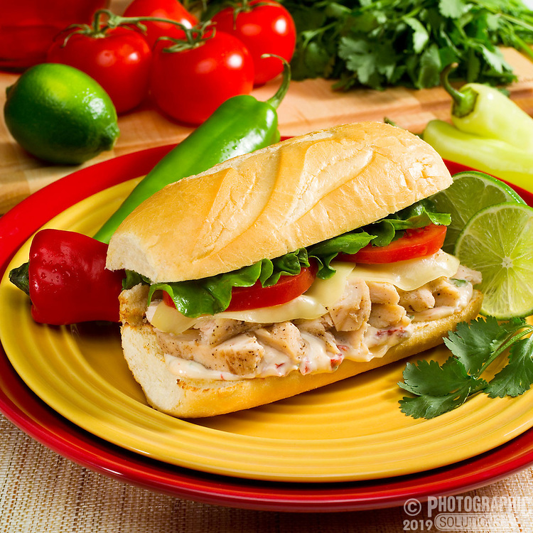 Southwest spicy chicken salad sandwich on colorful plates.