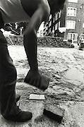 worker repaving a street
