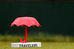 June 23, 2018 - Cromwell, CT, U.S. - CROMWELL, CT - JUNE 23: Raindrops on the Travelers tee marker on 1 during a wet Third Round of the Travelers Championship on June 23, 2018, at TPC River Highlands in Cromwell, Connecticut. (Photo by Fred Kfoury III/Icon Sportswire) (Credit Image: © Fred Kfoury Iii/Icon SMI via ZUMA Press)