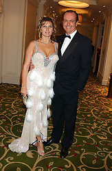 TV presenter and motoring correspondent QUENTIN WILSON and his wife MICHAELA  at the children's charity ChildLine 19th Birthday Ball held at the Grosvenor House Hotel, Park Lane, London on 29th October 2005.<br /><br /><br />NON EXCLUSIVE - WORLD RIGHTS