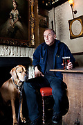 Swedish writer Håkan Nesser photographed in London. Nesser in the Scarsdale Tavern with his dog Norton.