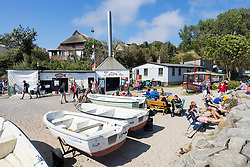 Cafes and tourists in historic former fishing village of Vitt on Wittow Peninsula of Rugen Island in Germany
