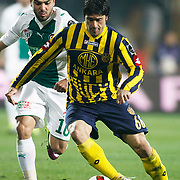 Bursaspor's Volkan SEN (L) and Ankaragucu's Adem KOCAK (R) during their Turkish soccer super league match Bursaspor between Ankaragucu at Ataturk Stadium in Bursa Turkey on Monday, 21 March 2011. Photo by TURKPIX