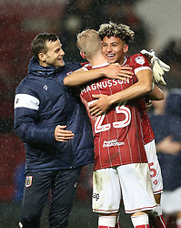 Bristol City's Lloyd Kelly (facing) celebrates with Hordur Bjorgvin Magnusson after the final whistle