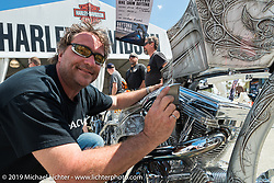 """Christian Rivard with his award winning """"Spartacus"""" bike on display Wednesday at the Ride-In Show at the Harley-Davidson display during Daytona Bike Week. FL, USA. March 12, 2014.  Photography ©2014 Michael Lichter."""