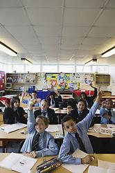 Enthusiastic classroom of  secondary school children,