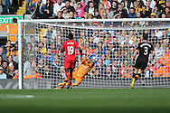 Sadio Mane of Liverpool shoots and scores his teams 3rd goal. FCPremier League match, Liverpool v Hull City at the Anfield stadium in Liverpool, Merseyside on Saturday 24th September 2016.<br /> pic by Chris Stading, Andrew Orchard sports photography.