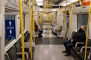 The day after the government introduced a third Coronavirus pandemic national lockdown, effectively a Tier 5 restriction, a tube train carriage remains quiet as the capital experiences a grim post-Christmas and millions of Britons are told to stay at home, on 5th January 2021, in London, England.