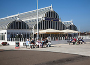 People sitting on benches enjoying sunny weather at East Point Pavilion, Seafront Lowestoft, Suffolk, England,