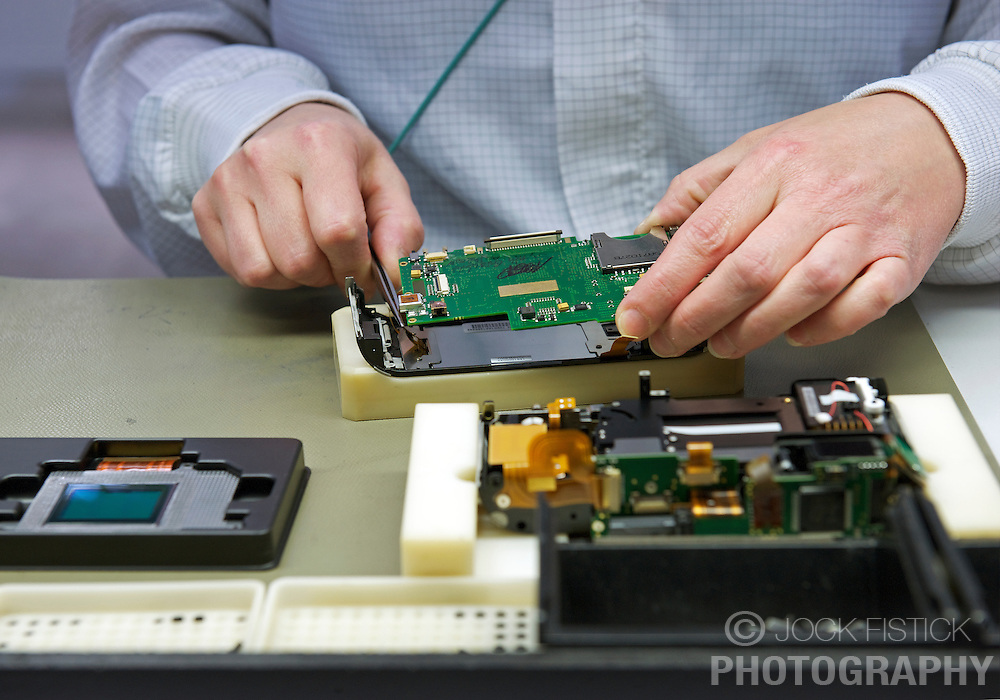 SOLMS, GERMANY - MAY-18-2009 - The Leica M8 arrives in Germany semi-pre-assembled, as much of the electronics of the main body and the camera back are made in Leica's facility in Portugal. In Solms, technicians insert the CCD which is made specifically for the M8 by Kodak, and then assemble the camera, attaching the front to the back and attaching the top and bottom plates. (Photo © Jock Fistick)