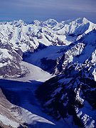Aerial view south across peaks of the Fairweather Range and Ferris Glacier in British Columbia toward 12,726 foot Mount Crillon in Glacier Bay National Park, Alaska.