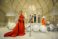 © Licensed to London News Pictures. 14/05/2012. London, UK. Model Zhanna Emelyanova poses in a red dress at a photocall for a Glorious ballgowns exhibition at the V&A's refurbished Fashion gallery in London on May 14, 2012. The show is exhibiting British Glamour Since 1950. Photo credit : Thomas Campean/LNP