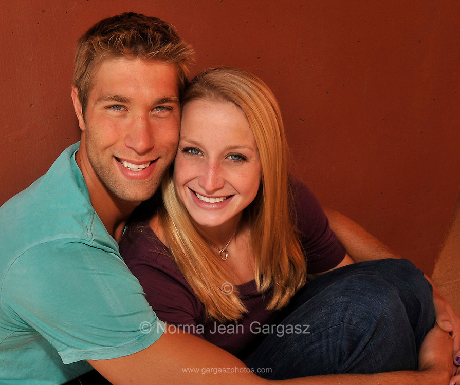 """Matt Grevers, (left), and Annie Chandler are U.S. National Swim Team members who train together at the University of Arizona.  They got engaged on February 11 after a race at a swim meet in Columbia, Missouri.  Matt won first place in backstroke.  When Annie presented the awards, Matt got down on one knee on the podium and proposed.  Annie said, """"Yes."""""""