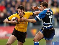 Photo: Richard Lane.<br />Bath Rugby v London Wasps. Zurich Premiership.<br />07/02/2004.<br />Tom Voyce breaks past Ollie Barkley.