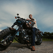 Cory Minton is one of the founders of The Legion Project, a non-profit group founded by veterans with a goal of providing community and belonging to US Military Veterans, First Responders, and Law Enforcement Officers through BJJ (Brazilian JuJitsu) instruction in central Ohio. Here Cory poses on his 2019 Harley-Davidson Fat Bob motorcycle.  (photo by Leonardo Carrizo)<br />  <br /> <br /> For more information on The Legion Project visit:<br /> https://www.facebook.com/thelegionproject2018/<br />  <br /> https://www.instagram.com/coryjminton/<br /> <br /> https://www.instagram.com/stars_and_strikes/
