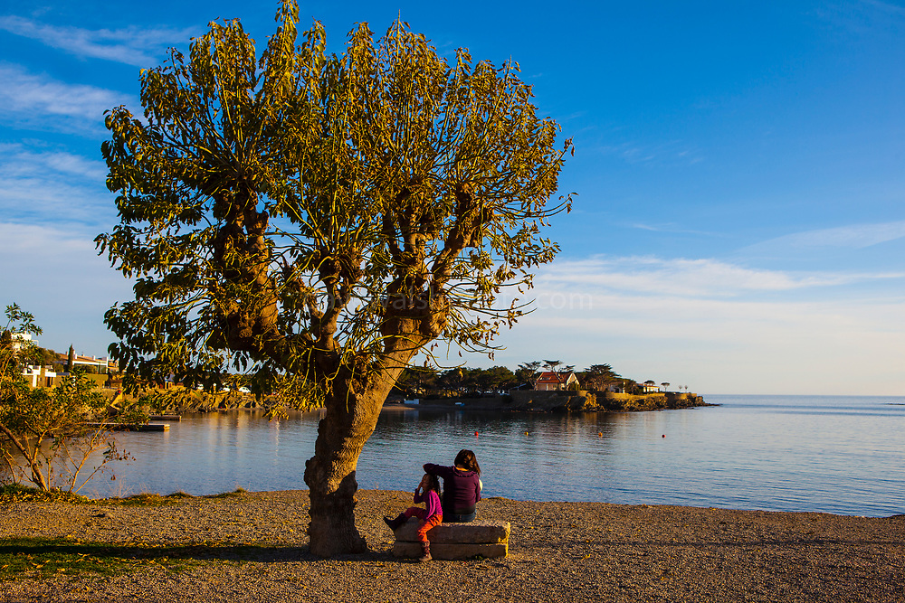 Mother and daughter, winter sunlight, Cadaques, Catalonia