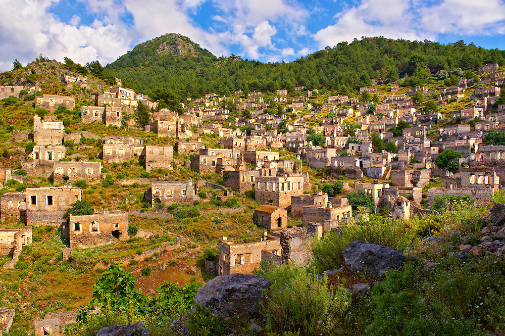 Kayaköy (Kayakoy) or Karmylassos, an abandoned Greek Village 8km from Fethiye in Turkey whose inhabitants left as part of a  population exchange agreement between the Turkish and Greek governments in 1923 after the Greco Turkish War. .<br /> <br /> If you prefer to buy from our ALAMY PHOTO LIBRARY  Collection visit : https://www.alamy.com/portfolio/paul-williams-funkystock/kayakoy.html<br /> <br /> Visit our TURKEY PHOTO COLLECTIONS for more photos to download or buy as wall art prints https://funkystock.photoshelter.com/gallery-collection/3f-Pictures-of-Turkey-Turkey-Photos-Images-Fotos/C0000U.hJWkZxAbg