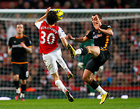20111227: LONDON, UK - Barclays Premier League 2011/2012: Arsenal vS Wolverhampton Wanderers.<br /> In photo: Yossi Benayoun of Arsenal and Nenad Milijas of Wolverhampton Wanderers fight for the ball.<br /> PHOTO: CITYFILES