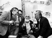 A few friends drop by to celebrate Noel Purcell's eighty-first birthday with him in the Adelaide Hospital, Dublin. (l–r): Gay Byrne, Hal Roche, Noel Purcell and Joe Lynch, as they sing an old song from many years ago.<br /> 23 December 1981