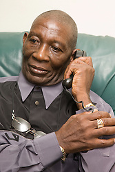 Older man answering the telephone,