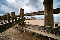 Portobello town promenade viewed through wooden groyne on Portobello beach , Scotland, UK