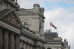 © Licensed to London News Pictures. 09/04/2021. London, UK. The Union Jack above the Foreign, Commonwealth and Development Office is lowered to half mast following the death of Prince Philip. The Duke of Edinburgh Prince Philip, Queen Elizabeth II's husband, has died aged 99 Buckingham Palace has announced. Photo credit: Rob Pinney/LNP