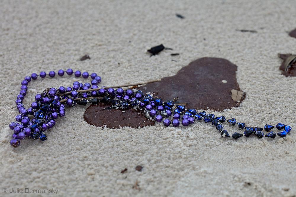 Oil tar ball  from the BP oil spill in Long Beach, Mississippi.