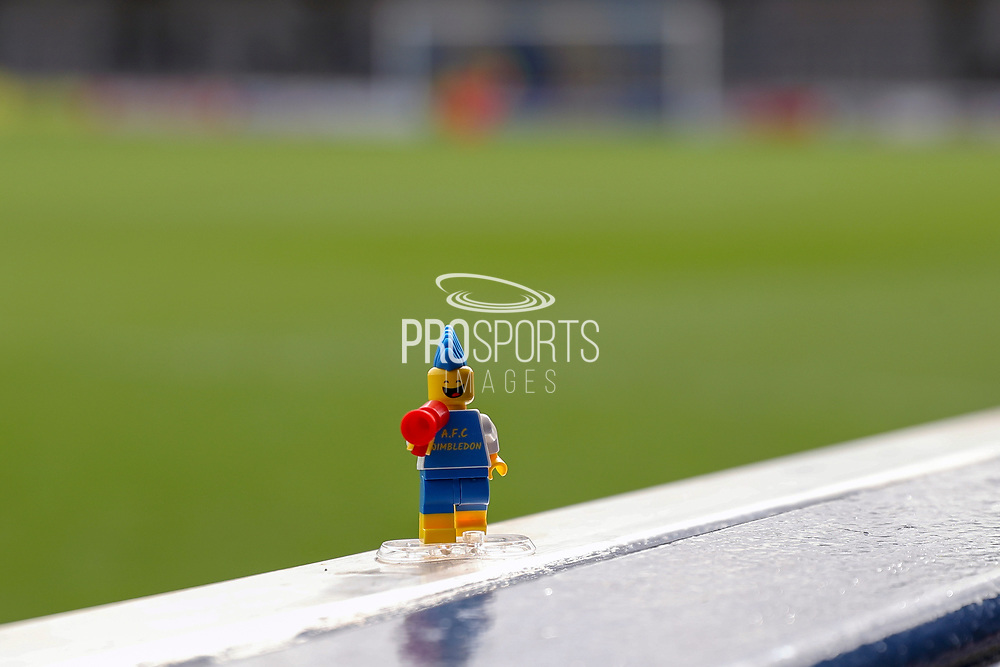 Lego figure with AFC Wimbledon on the front during the EFL Sky Bet League 1 match between AFC Wimbledon and Gillingham at the Cherry Red Records Stadium, Kingston, England on 23 March 2019.