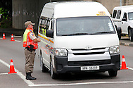 DURBAN - 20 November 2016 - An officer from the KwaZulu-Natal Traffic Police stops a mini-bus taxi at the intersection of Richmond Raod and the M13. Picture: Allied Picture Press/APP